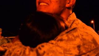 Marine homecoming/ best son father hug ever.