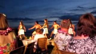 Maui luau dancers in white costumes
