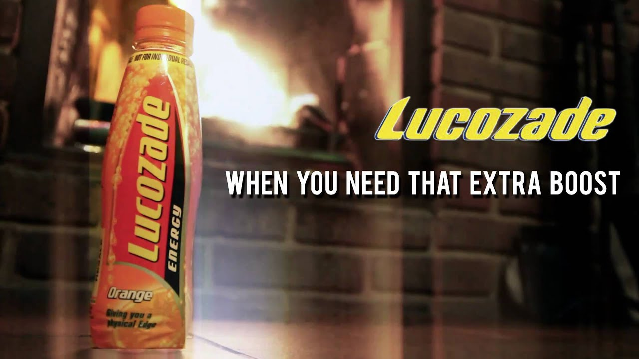 An Old Lucozade Advert On The Side Of A Building, Against A Clear ...