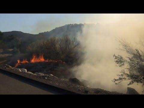 Associated Press: Powerful winds push California wildfire flames