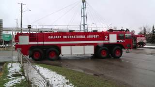 ***EXCLUSIVE*** Calgary Police Escort Airport Fire Truck & Airport Authority Sweeper!!