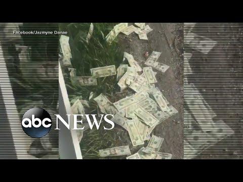 Armored Truck Spills Money On Highway