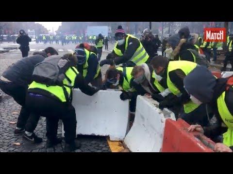 """Les """"gilets jaunes"""" investissent Paris : tensions sur les Champs-Elysées"""