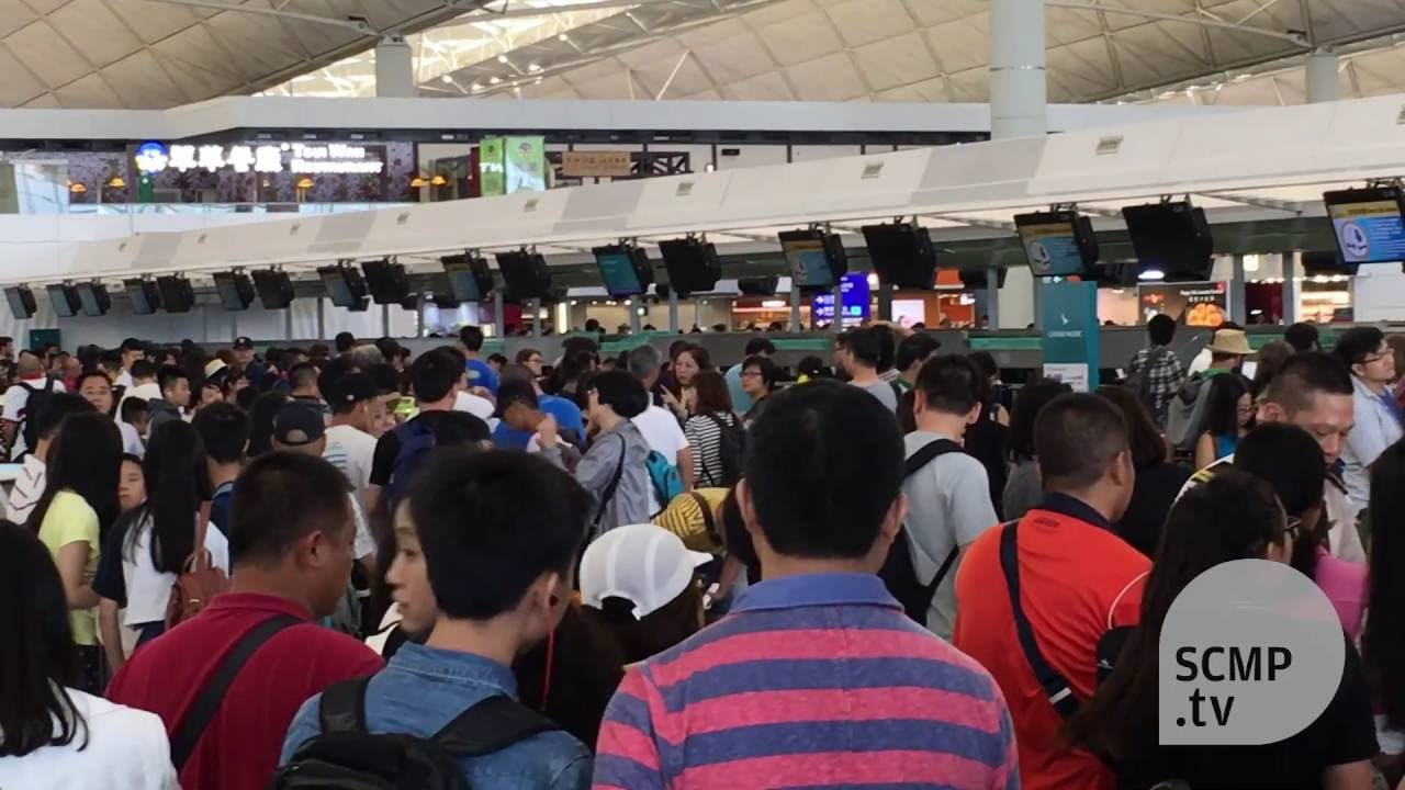 Passengers wait for hours at the Cathay Pacific check in counters - YouTube
