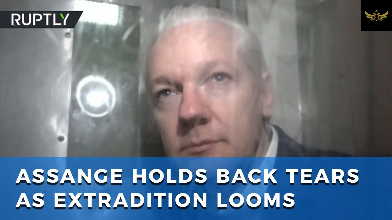 Assange holds back tears, as rigged extradition to US looms