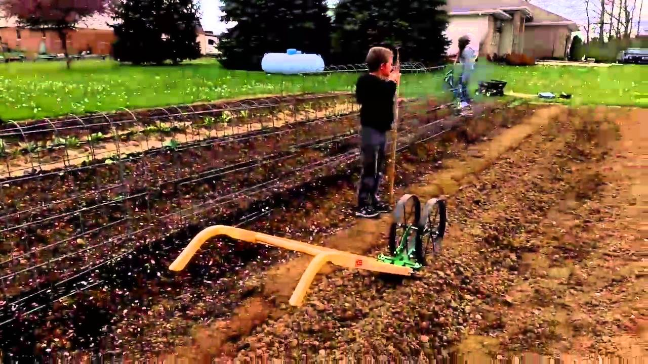 Planting Potatoes With the Hoss Wheel Hoe - YouTube