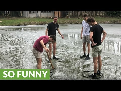 Kids On Frozen Lake Play Game Trying To Break Ice With Axe
