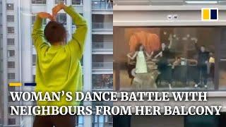 Coronavirus: Chinese woman starts dance battle with neighbours from her balcony
