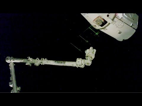 SpaceX Dragon supply ship docks at international space station