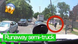 Runaway FedEx truck rolls down Minnesota street and crashes into a tree.