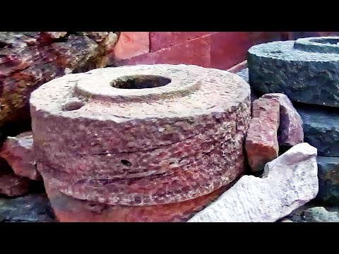 Ancient Hand operated millstone or  Rock Flour Mill.wmv