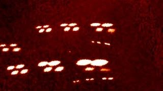 Massive amount of UFOS in Formation passes Satellite Camera.