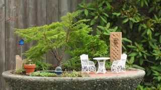 A tutorial on how to use different miniature garden accessory sizes...