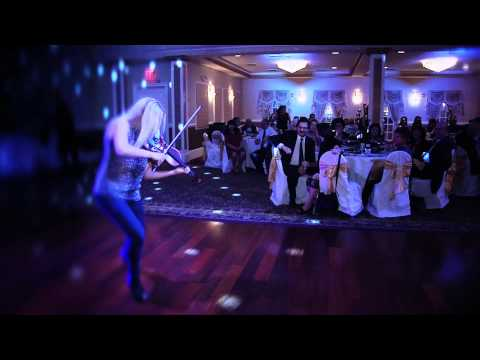 Violinist Alina performs during a post-wedding party in Baltimore, MD