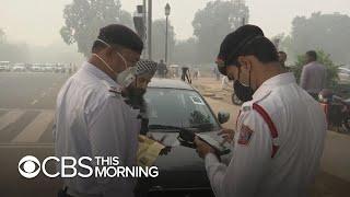 India's capital closes schools, restricts cars amid pollution crisis