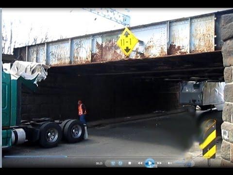 Truck accident in Stratford Ct truck stuck under bridge near 95 highway  Merritt parkway