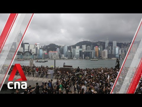 Hong Kong protesters rally outside West Kowloon station