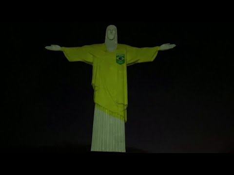 Rio's Christ the Redeemer lit up to mark 100 days until Olympics