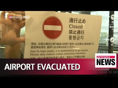 Passengers and workers evacuated from Japan's Kansai International Airport after..