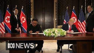 Donald Trump and Kim Jong-un sign document after summit