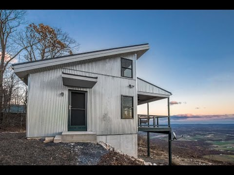 Mountaintop Cabin with an Amazing View and a Black Metal Roof - A.B. Martin