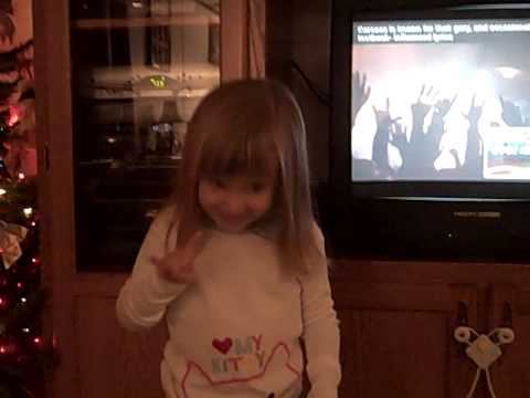 Abby Rocks Out To Some Heavy Metal Music
