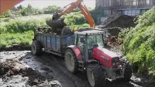 Emptying the Slurry Lagoon with 3 Spreaders and Hitachi Digger
