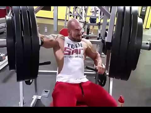 hammer strength single arm press)