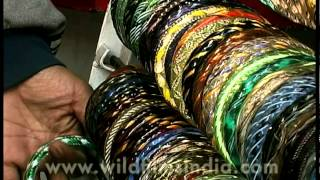 Colorful Indian bangles displayed in racks, Dillii Haat