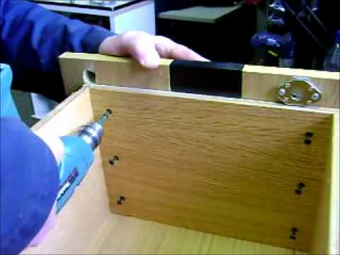 Install Simple Swing Cam Lock In Bottom Drawer Of Wood Cabinet