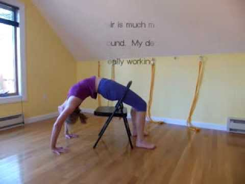 practicing urdhva dhanurasana with the legs through a