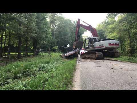 Link Belt Excavator Pulls out John Deere Log Skidder