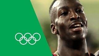 Michael Johnson walks through his Atlanta 200m/400m victories
