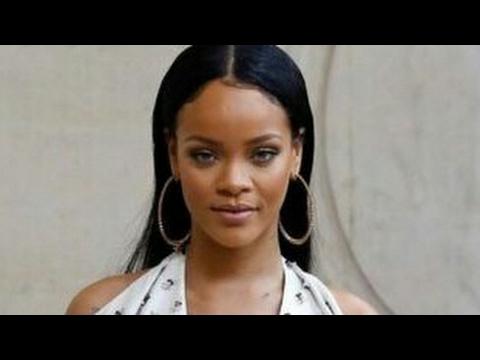 Rihanna Hits A Fan Upside The Head With Microphone