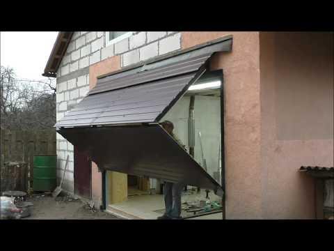 видео: Подъемно-складные ворота в гараже (мастерской)