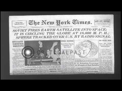 New York Times headlines about soviet firing satellite into space. HD Stock Footage