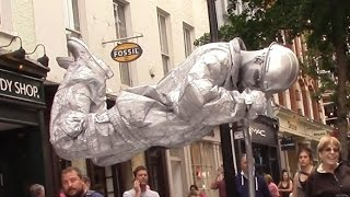 Video Silver man secret revealed London street performer, floating and levitating trick download MP3, 3GP, MP4, WEBM, AVI, FLV Agustus 2017