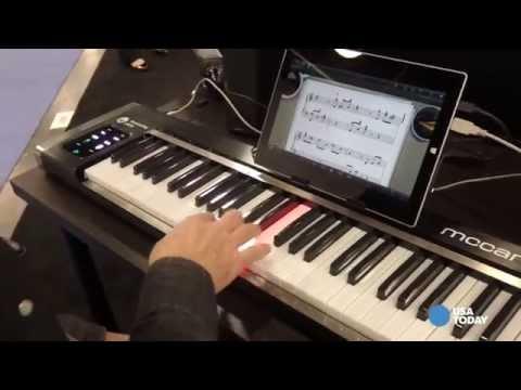 Piano illuminates and shows you keys to play - NAMM2015