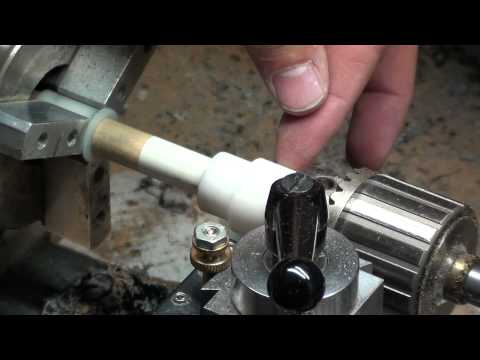 Installing a triangle cue tip using a tip centering tool
