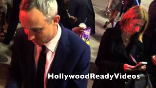 Wallace Langham shows love to fans departing the Draft Day premiere in Westwood