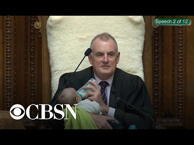 New Zealand lawmaker holds baby during debate