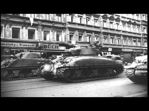 United States Infantry troops patrol on streets of Leipzig, Germany and civilians...HD Stock Footage