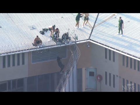 Prisoners seen on roof of Australian prison amid fire