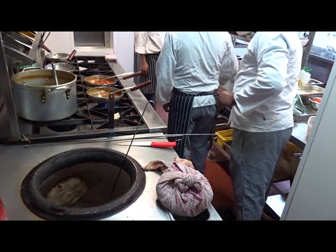 Indian Restaurant Kitchen: Very Busy and Fast Action at Taste of India, Drummond Street, London.