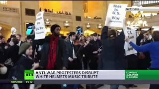 'USA Out Of Everywhere' Anti Syrian war protest disrupts White Helmets pop up music tribute