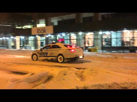 NYPD CRUISER PATROLLING ON BROADWAY ON WEST SIDE OF MANHATTAN, NEW YORK, DURING WINTER STORM JONAS.