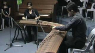 Dance of Yao People 瑶族舞曲 Guzheng Duet. Madeline Ashlee Lok & Soh Zhong Yao