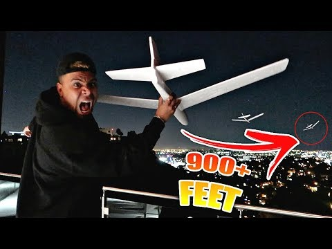 WORLD RECORD PAPER AIRPLANE LONGEST THROW!! (OFF THE CLOUT HOUSE ROOF)