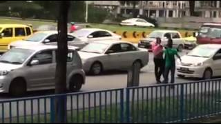 Traffic collision involving African man turns ugly