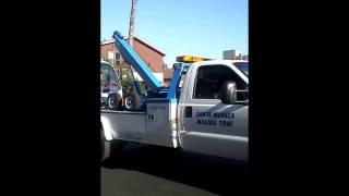Santa Monica Malibu Tow,  towing Isuzu NPR HD Dump